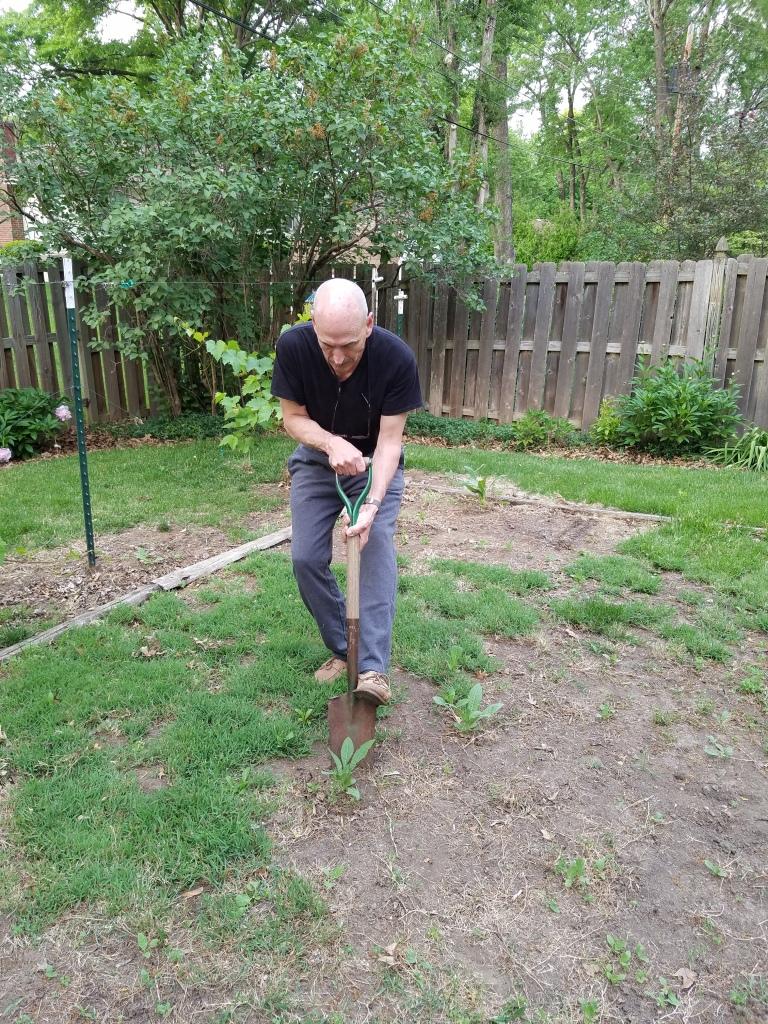 dad weeding garden