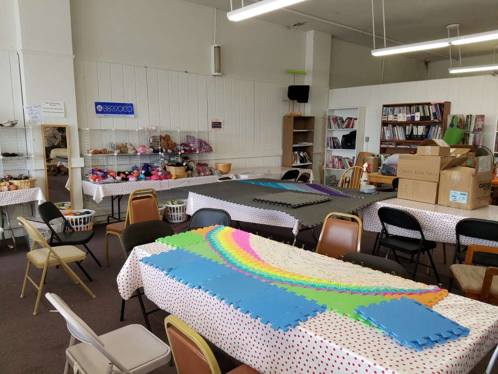 Shawls blocking in Mass Ave Knit Shop sale room