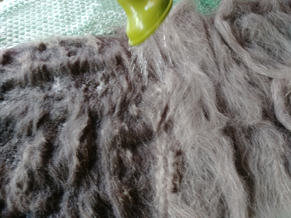 pouring hot water on the wool
