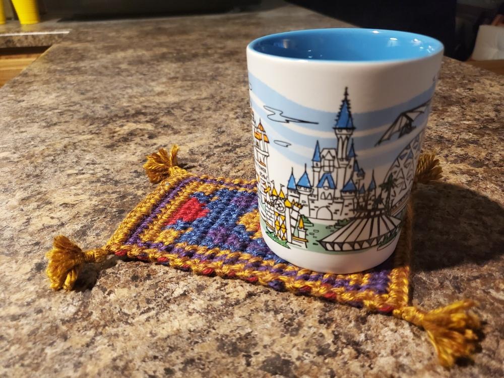 coffee cup on the magic mug rug