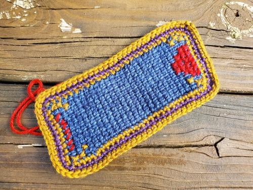 Cross-stitch tunisian crochet mug rug in progress