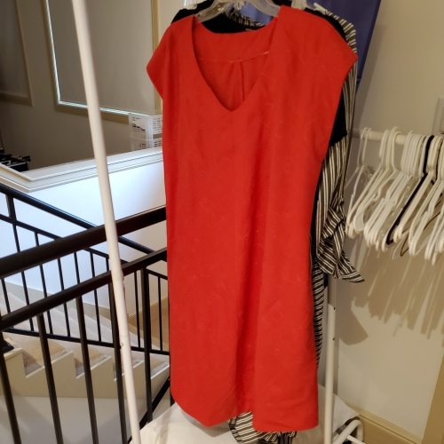 emerald dress on a hanger