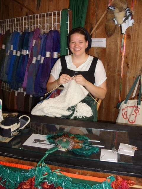 Emma knitting in the Renaissance Festival booth