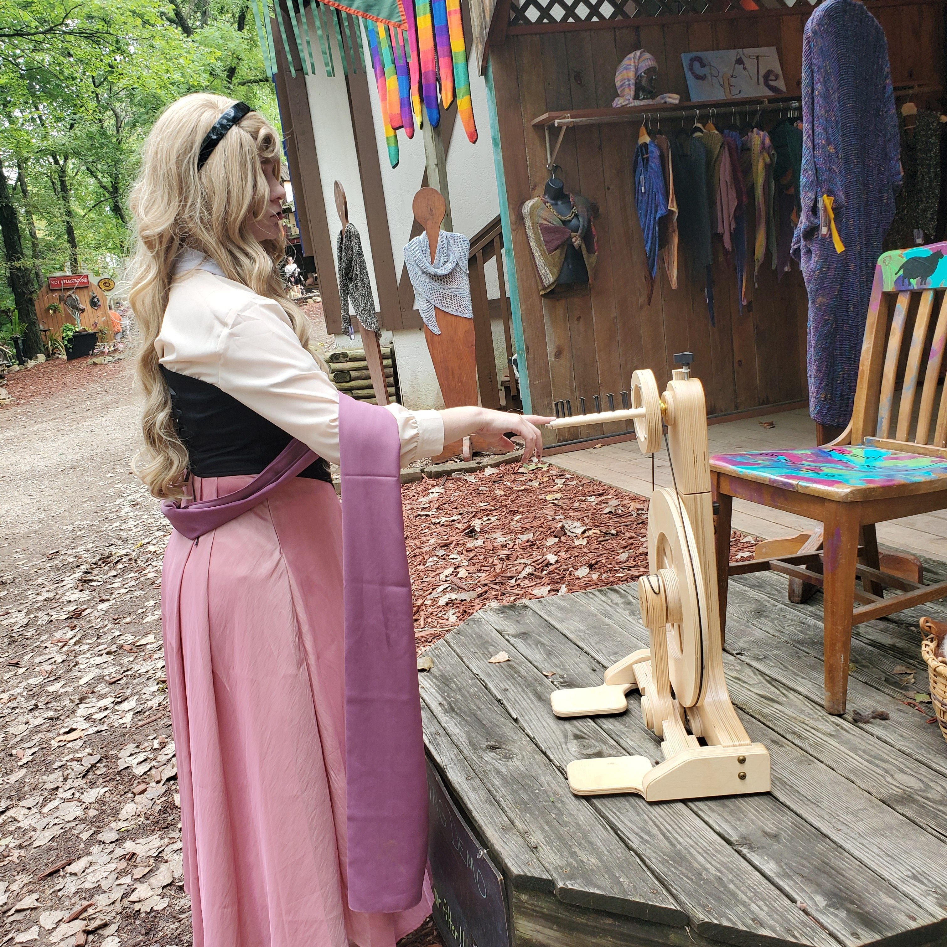 Sleeping Beauty pricking her finger on the spinning wheel