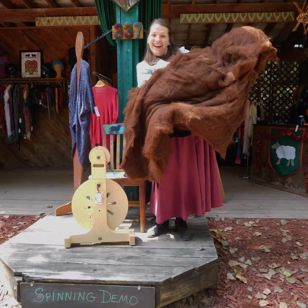Emma holding a giant batt of alpaca