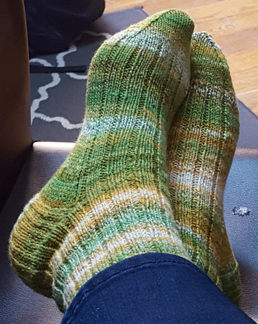 striped green, white, and gold socks