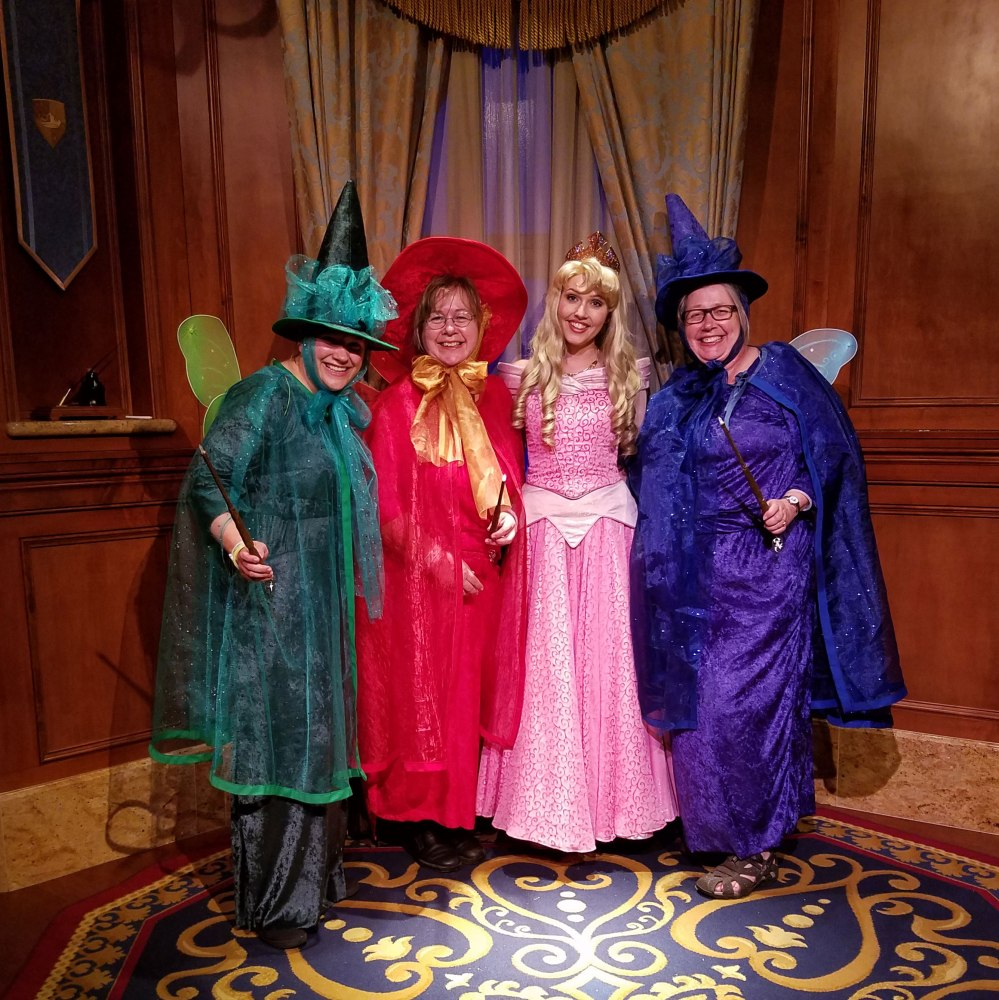 Emma, her aunt Kathy, Princess Aurora, and her Mom