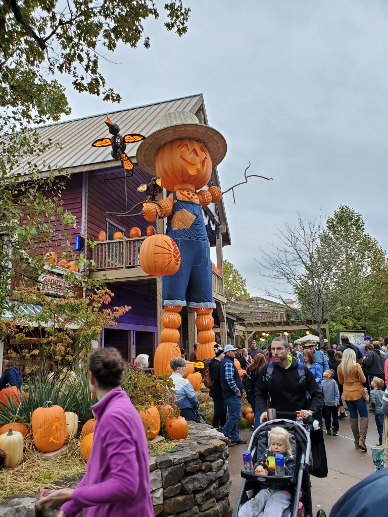 Giant farmer jack-o-lantern scarecrow