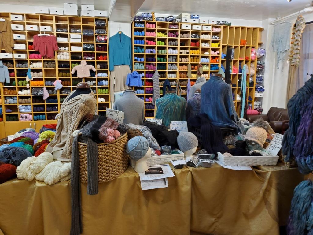samples and yarn shelves at School Products Yarns