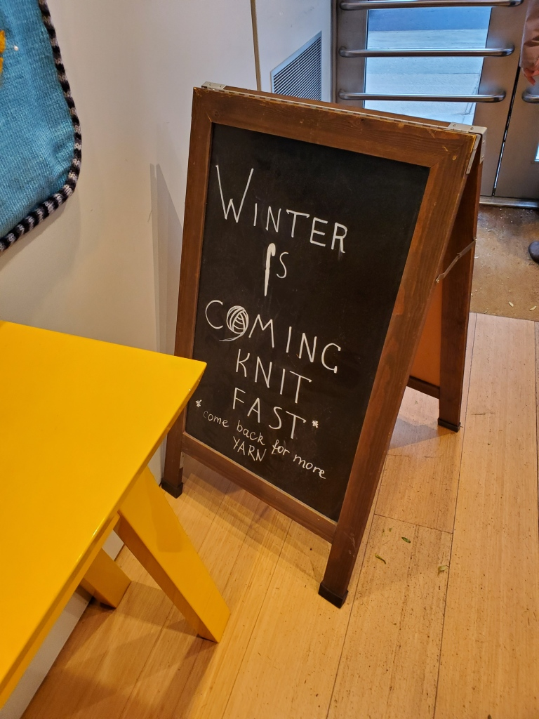 "Sign that says ""Winter is Coming. Knit Fast. Come back for more YARN."""