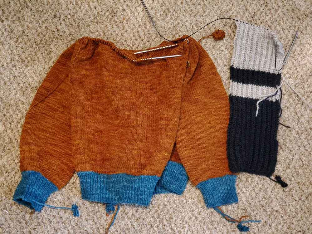 2/3 of a sweater and 1/3 of a scarf