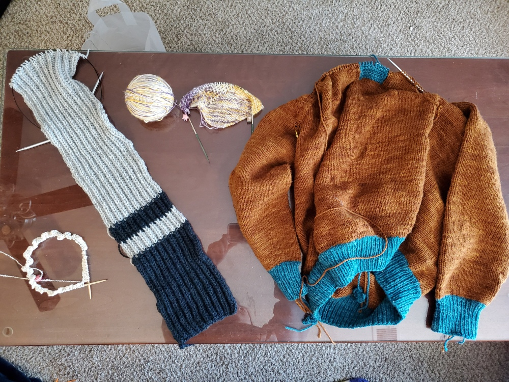 In-progress projects: crop top, ribbed scarf, cowldana, and sweater.