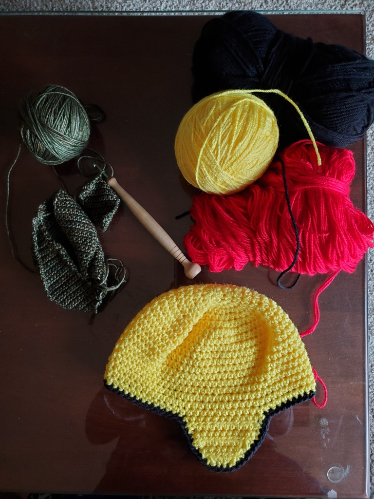Two in-progress hats