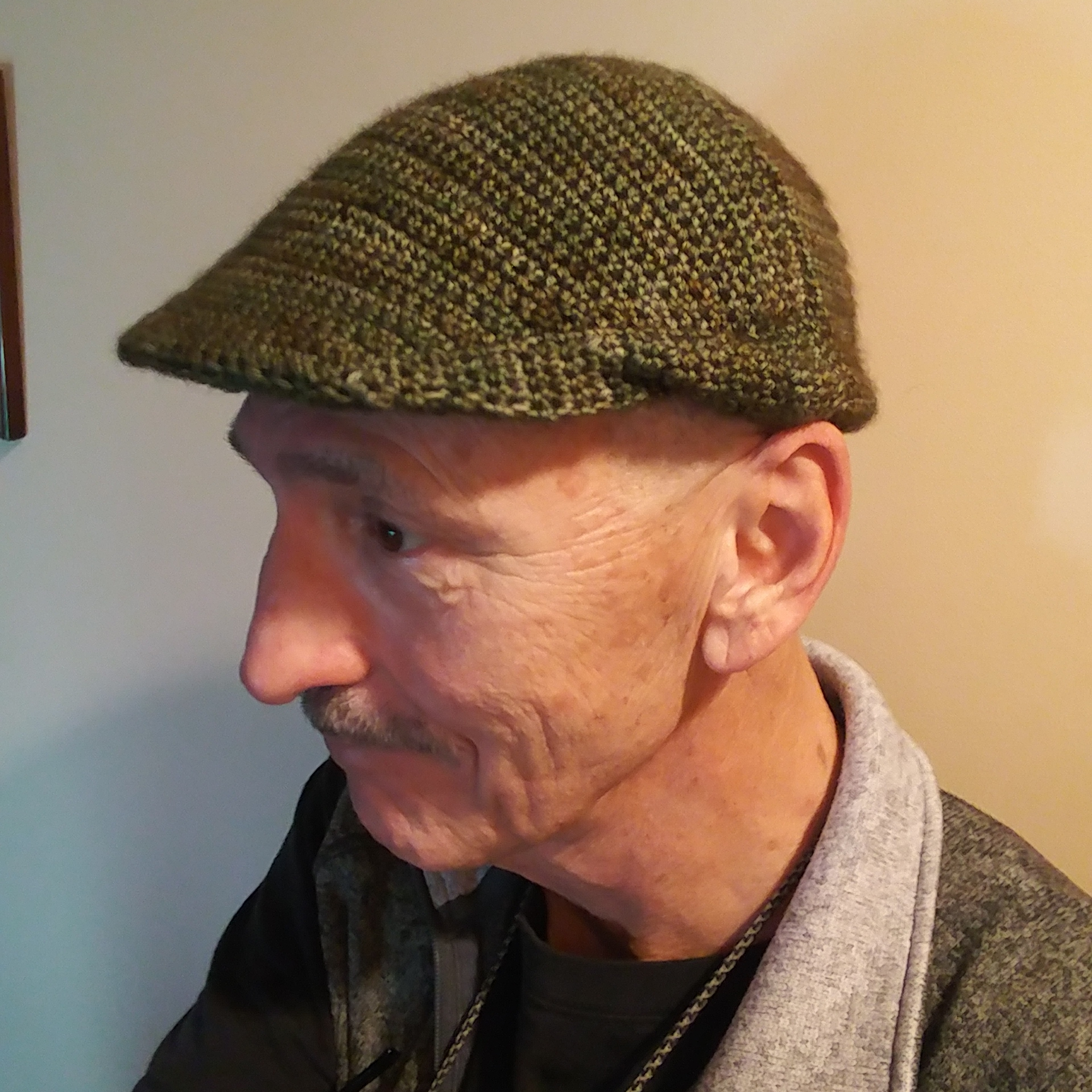 Dad in his crocheted cheese-cutter hat