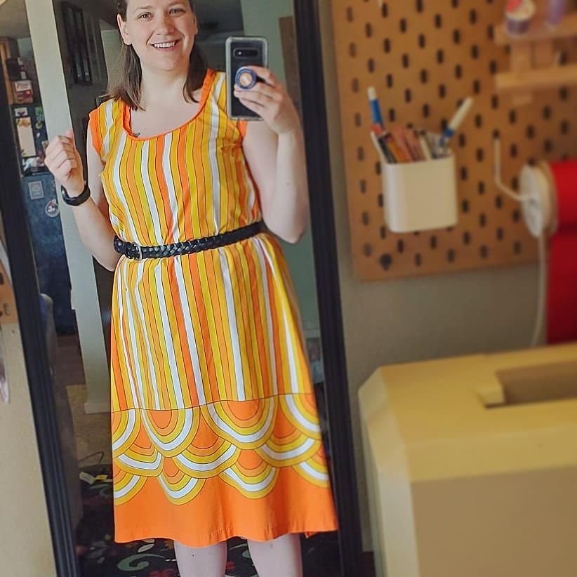 Emma in an orange patterned dress