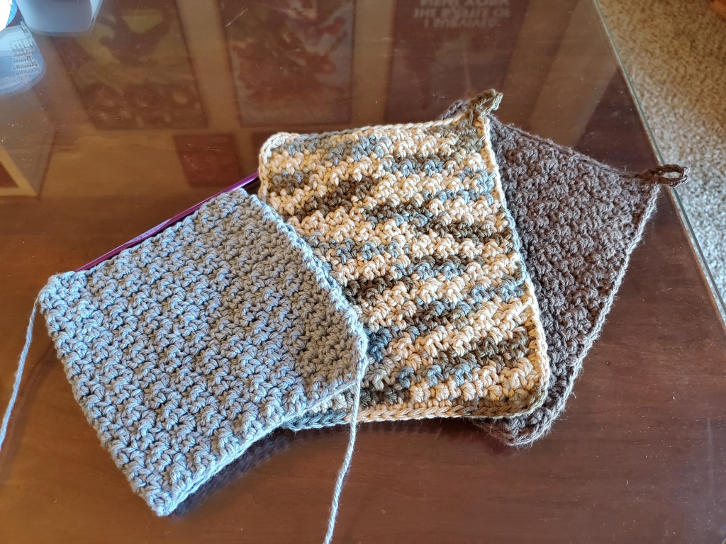two finished hot pads, one in progress