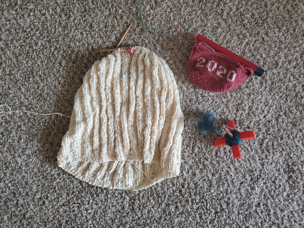 In-progress crop top, Little House, and spinning project
