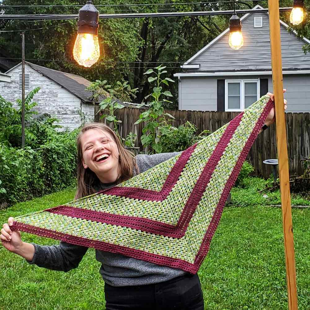 Emma holding up her Drive-In Shawl