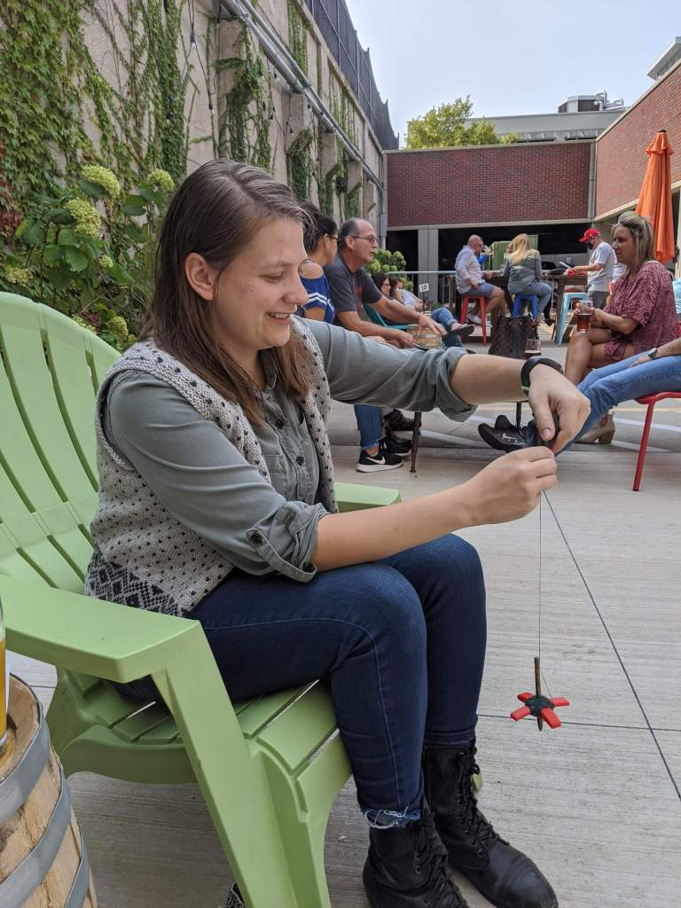 Emma spinning on a Turkish drop spindle at Boulevard Beer Hall