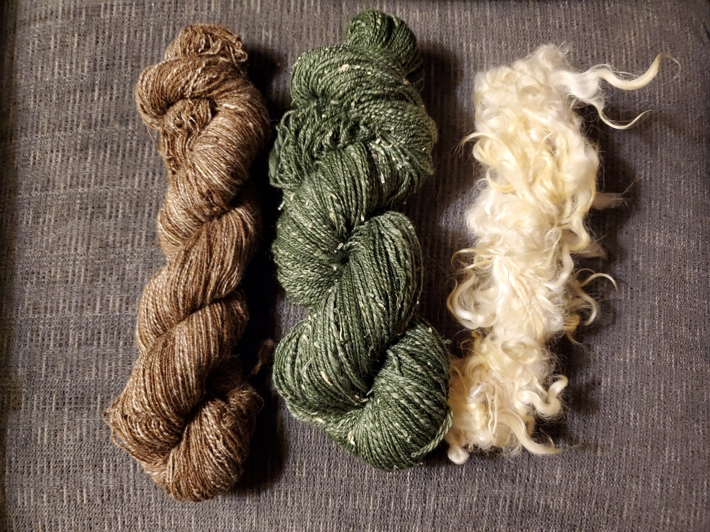 three skeins of handspun yarn