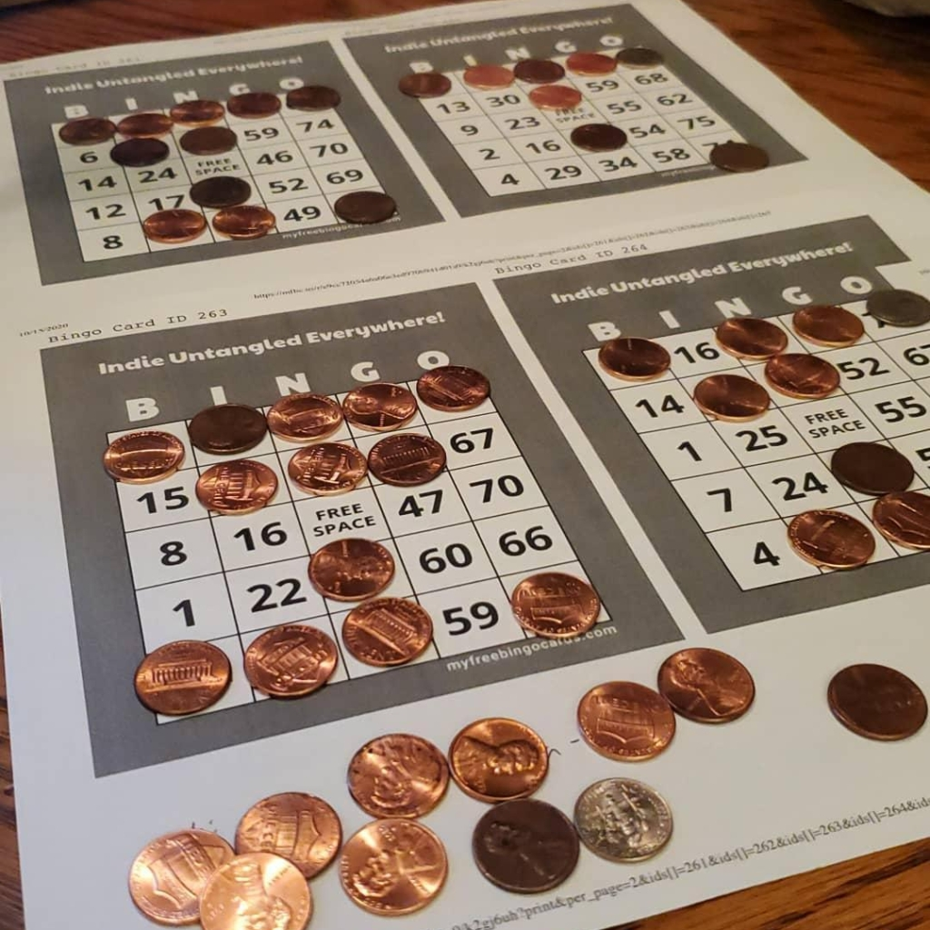 Bingo cards with pennies on them