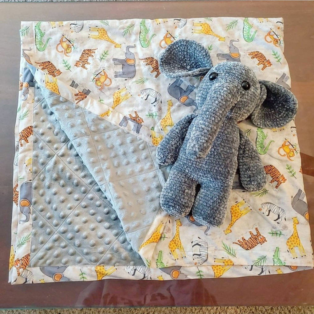 Baby quilt and elephant stuffed animal