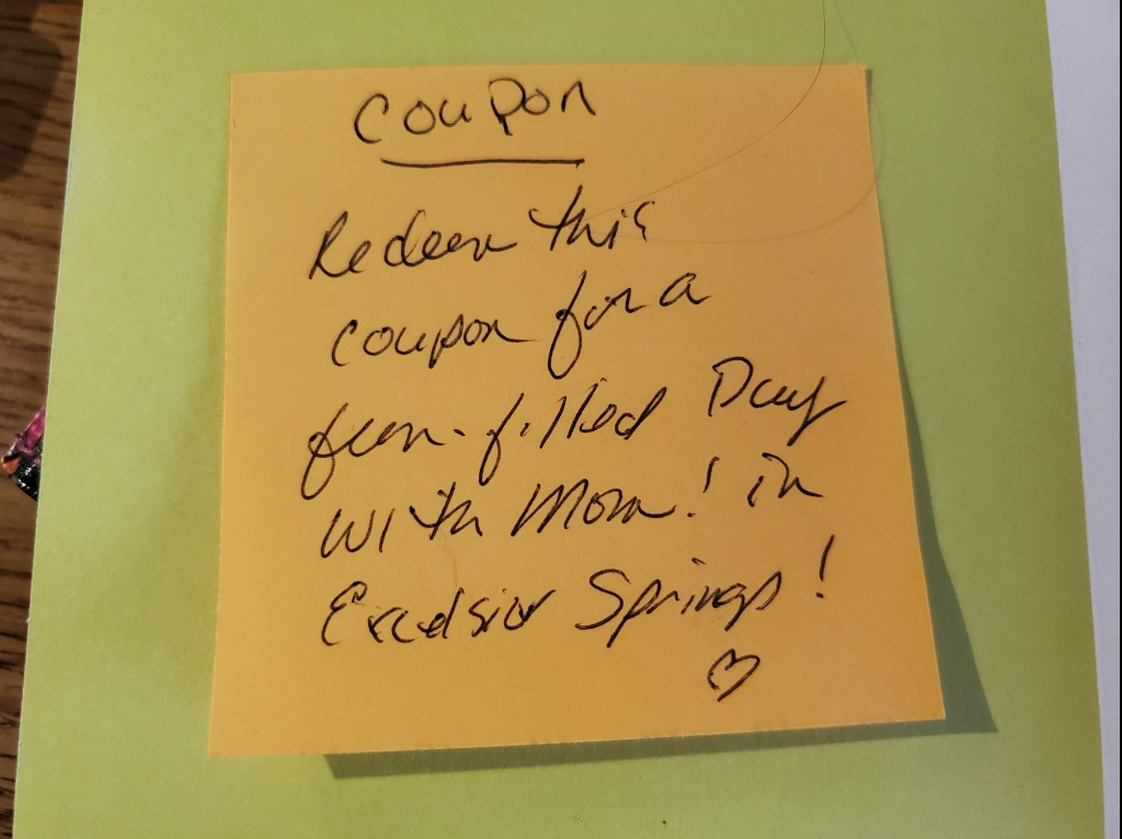 """a post-it that reads """"Coupon. Redeem this coupon for a fun-filled day with Mom! in Excelsior Springs!"""