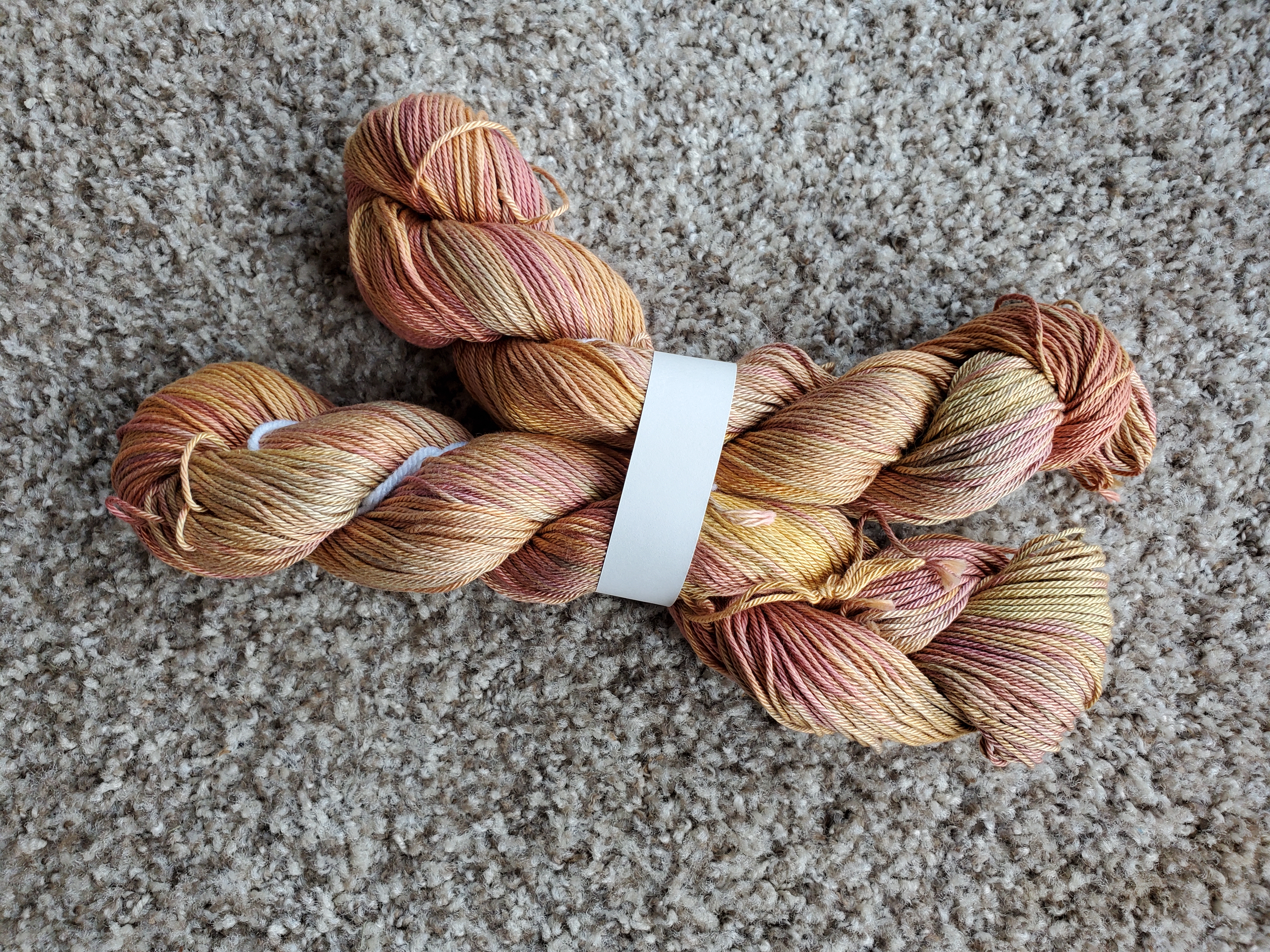 Two skeins of hand-dyed cotton yarn