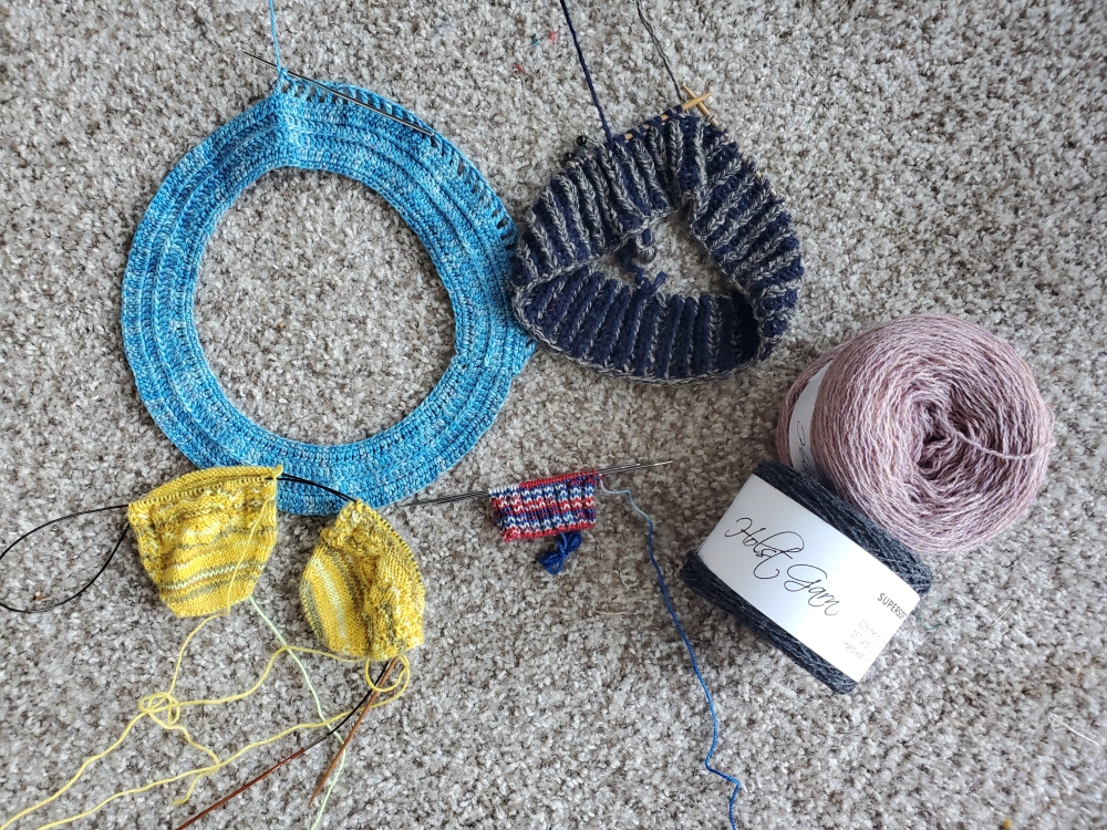 Four in-progress project and two cakes of yarn